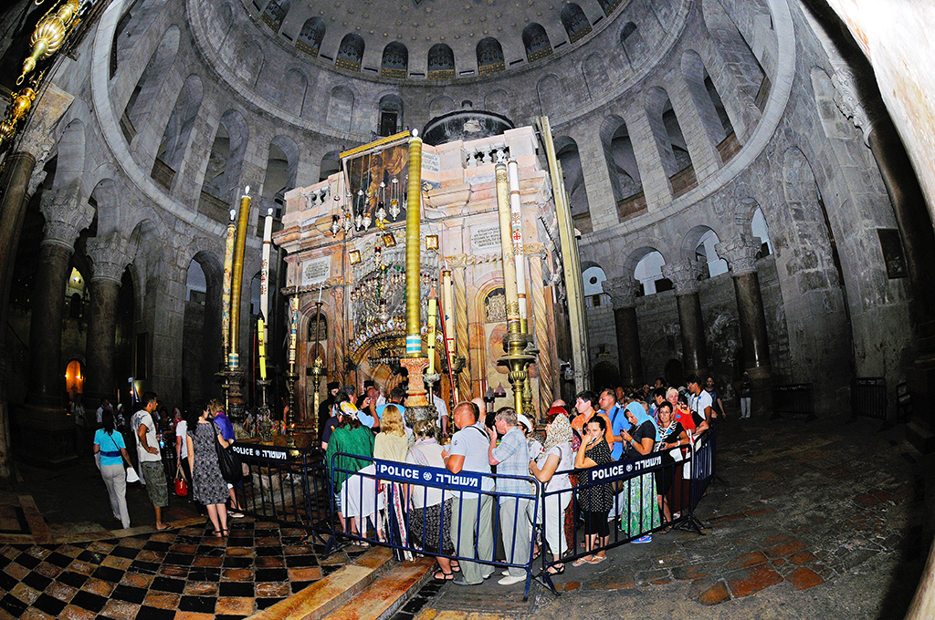 The most important site of the Church of the Holy Sepulchre is the Aedicule (Holy Grave, Grave Chapel), the supposed location of Jesus' grave and the 14th statio of the Via Dolorosa, that is visited by thousands of pilgrims and tourists daily, in Jerusalem, Israel, 12 September 2013. The Via Dolorosa (Way of Suffering) is a street in the old town of Jerusalem named after the path Jesus of Nazareth walked to his crucification. Jesus carried the cross, on which he later died via that road from the Antonia Fortress, then seat of Pilate, to Golgotha, the place where his grave is supposedly located. Above this place, the Church of the Holy Sepulchre was later built. The path led Jesus via 14 stations that are often visited by modern pilgrims walking through the old town. Photo: Matthias Tödt