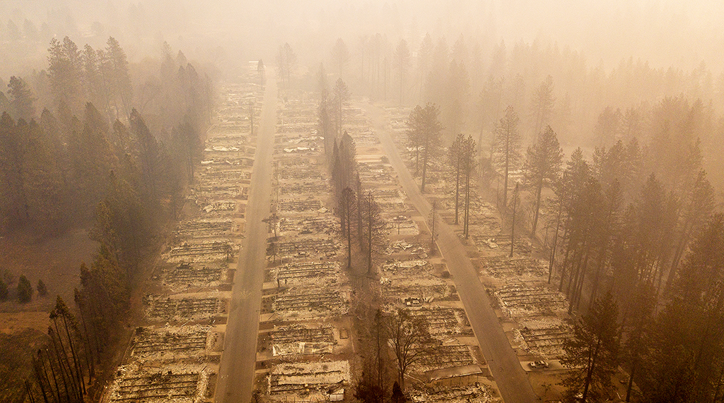 In this aerial photo, a burned neighborhood is seen in Paradise, California on November 15, 2018. - The toll in the deadliest wildfires in recent California history climbed to 59 on November 14, 2018, as authorities released a list of 130 people still missing. (Photo by Josh Edelson / AFP)