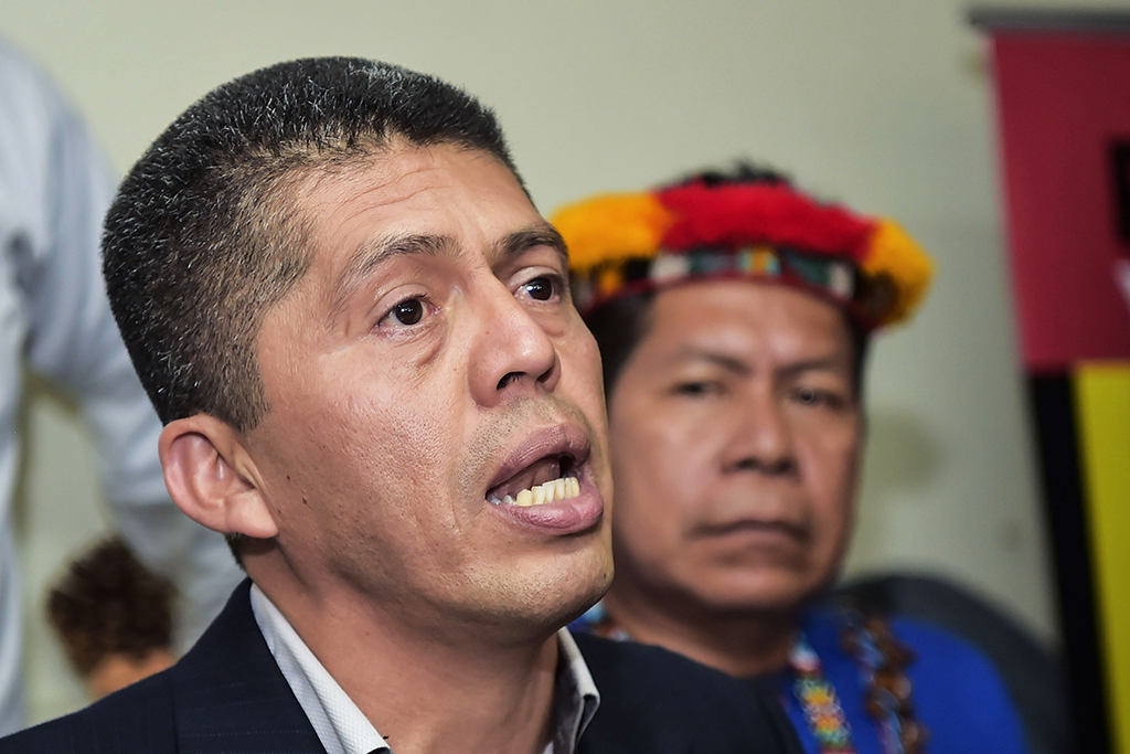 Pablo Fajardo, lawyer of the victims of environmental damage caused during oil operations in the Ecuadoran Amazon from 1964 to 1990 blamed on Texaco, which Chevron acquired in 2001, speaks during a press conference in Quito on September 10, 2018. - Fajardo said they are going to defend at all costs the judicial sentence they legitimately won, after an appeals court in The Hague has cancelled $9.5 billion in damages handed down by an Ecuadoran court against American energy giant Chevron for causing oil pollution in the Amazon jungle. (Photo by RODRIGO BUENDIA / AFP)