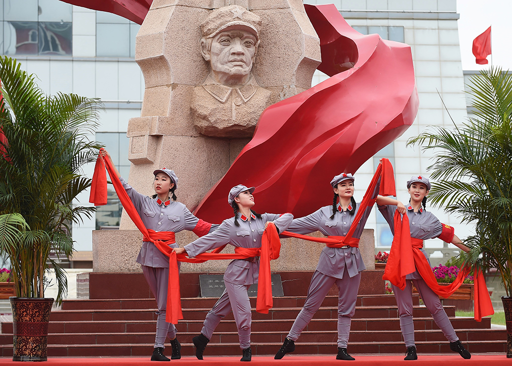 (190818) -- HUINING, Aug. 18, 2019 (Xinhua) -- Artists perform during an event marking the conclusion of an activity that took journalists to retrace the route of the Long March, in Huining, northwest China's Gansu Province, Aug. 18, 2019. The activity, held from June 11 to Aug. 18, was aimed at paying tribute to the revolutionary martyrs and passing on the traditions of revolution. The Long March was a military maneuver carried out by the Chinese Workers' and Peasants' Red Army from 1934 to 1936. During this period, they left their bases and marched through rivers, mountains and arid grassland to break the siege of Kuomintang forces and continue to fight Japanese aggressors. Many marched as far as 12,500 km. (Xinhua/Luo Xiaoguang)