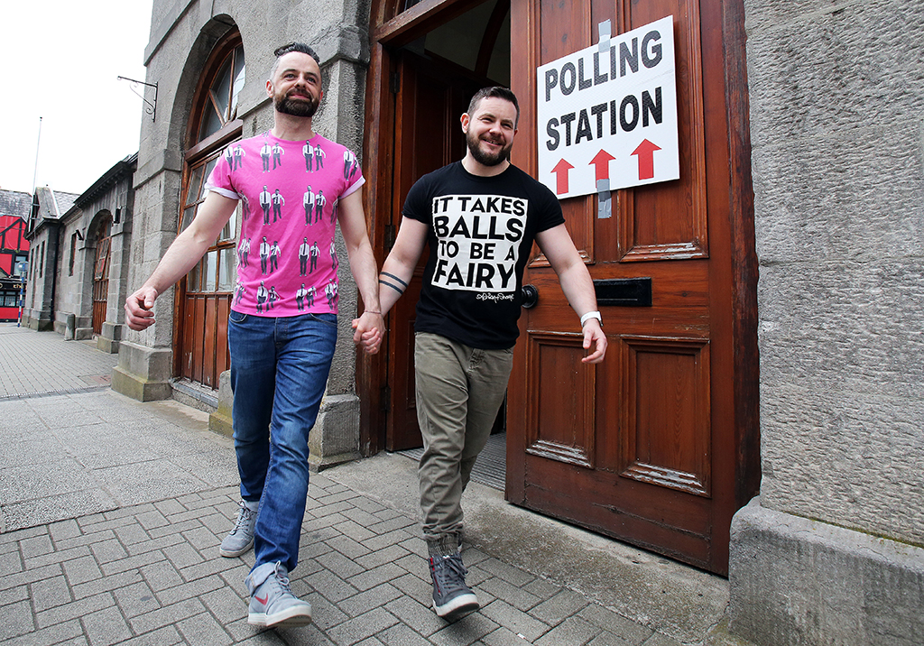 A gay couple pose holding hands as they walk out of a polling station after voting in Drogheda, north Dublin on May 22, 2015. Ireland took to the polls today to vote on whether same-sex marriage should be legal, in a referendum that has exposed sharp divisions between communities in this traditionally Catholic nation.   AFP PHOTO / Paul Faith (Photo by PAUL FAITH / AFP)