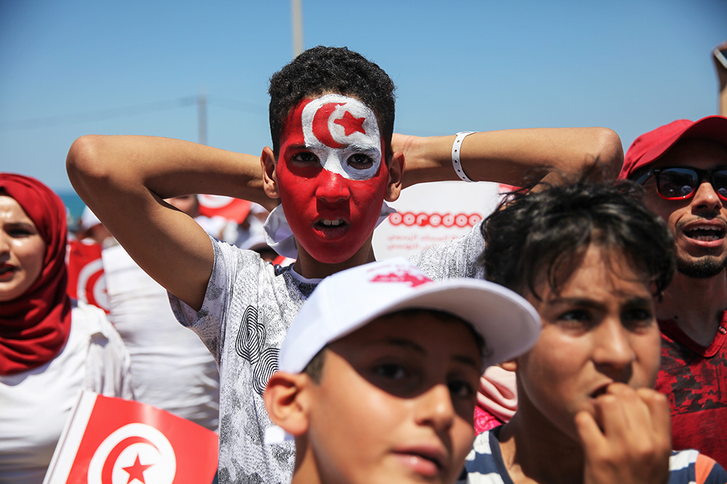 A young man reacts during a public viewing event held on the beach of Marsa, a coastal town in far north eastern Tunisia near the capital Tunis, on June 23, 2018, to watch the FIFA World Cup 2018 Group G soccer match between Tunisia and Belgium. (Photo by Chedly Ben Ibrahim/NurPhoto)