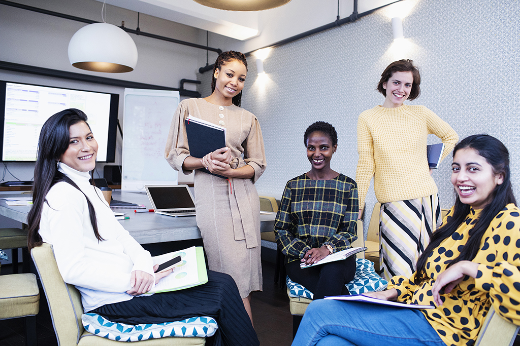 Portrait confident businesswomen in conference room meeting.