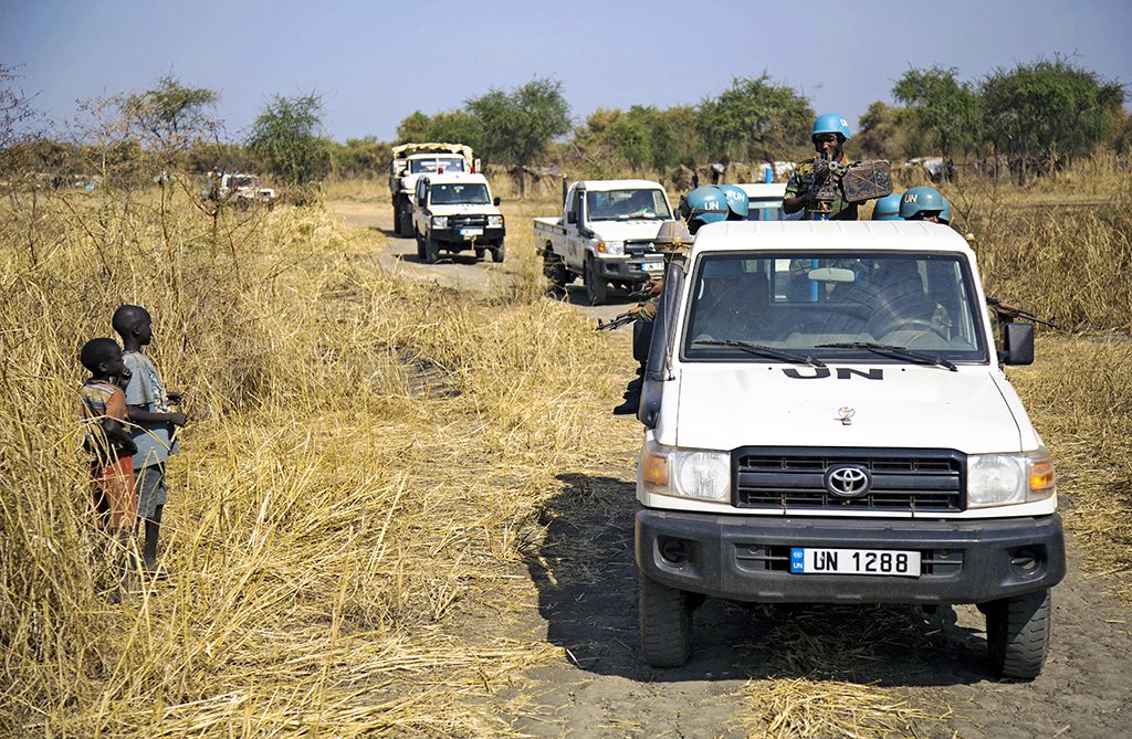Peacekeeper troops from Ethiopia and deployed in the UN Interim Security Force for Abyei (UNISFA) patrol outside Abyei town, in Abyei state, on December 14, 2016. - The Abyei Administrative Area is a disputed territory between Sudan and South Sudan with longstanding intercommunal tensions between the Ngok-Dinka ethnic majority and the pastoral Misseriya population, who migrate through the area seasonally from the north. An attack by Government of Sudan forces on Abyei in May 2011 displaced the majority of the Ngok Dinka population, approximately 105,000 people to areas south of the River Kiir, which became overcrowded and are suffering a huge competition over natural resources. (Photo by ALBERT GONZALEZ FARRAN / AFP)