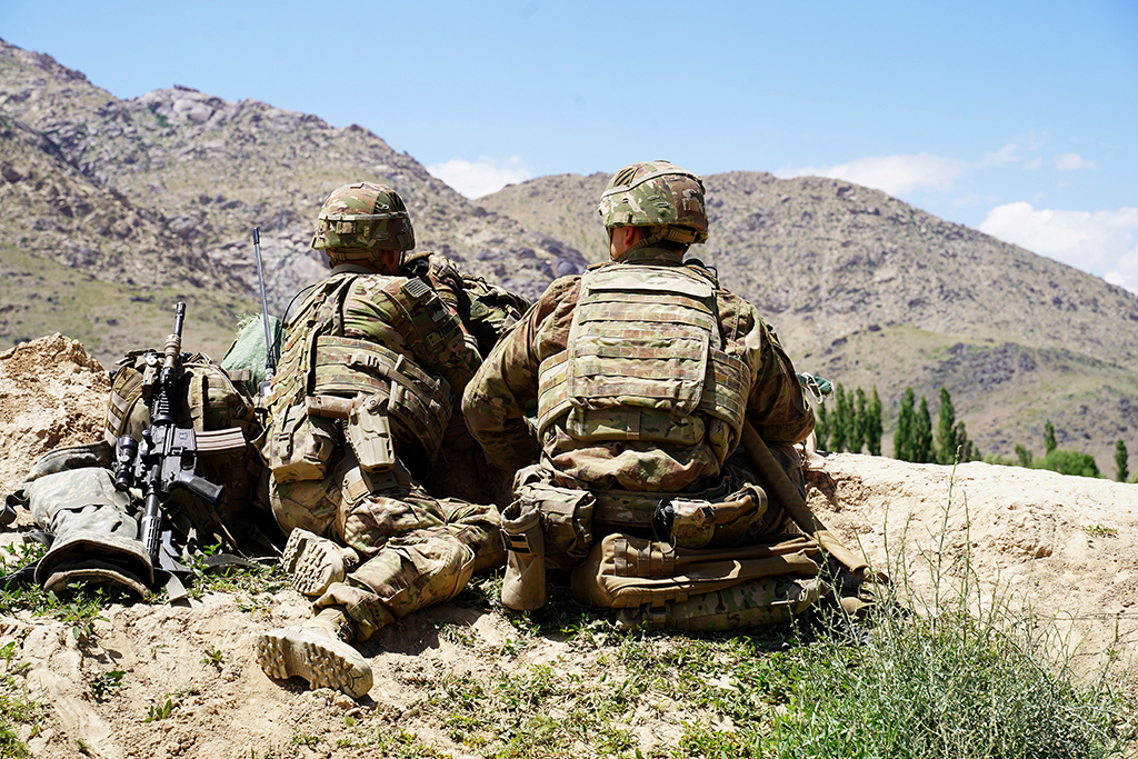 "(FILES) In this file photo taken on June 6, 2019, US soldiers look out over hillsides during a visit of the commander of US and NATO forces in Afghanistan General Scott Miller at the Afghan National Army (ANA) checkpoint in Nerkh district of Wardak province. - The United States has secured a seven-day reduction in violence in talks to help seek a negotiated settlement in Afghanistan, Pentagon chief Mark Esper said February 13, 2020. The announcement came as NATO defence ministers met in Brussels and a day after Afghan President Ashraf Ghani reported ""notable progress"" in negotiations with the Islamist insurgents.""The United States and the Taliban have negotiated a proposal for a seven-day reduction in violence,"" Esper told reporters, dubbing his meetings with NATO colleagues ""productive."" (Photo by THOMAS WATKINS / AFP)"