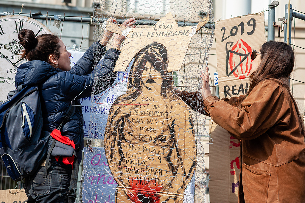 March 31st, Brussels. At the same time that a March for life was celebrated in Brussels, the Belgian collective 'Collecti.ef 8 maars' organized a 'Defend abortion right' demonstration at the Brussels central station. Since October 2018 in Belgium, abortion is no longer regulated by the penal code but by the civil code. Just before the final vote in September 2018, several thousand people had walked the streets of Brussels to demand real decriminalization of abortion. The organization also asked to the people to bring their metal coat hangers for a collective installation honoring women who died from an unsafe abortion. (Photo by Romy Arroyo Fernandez/NurPhoto)