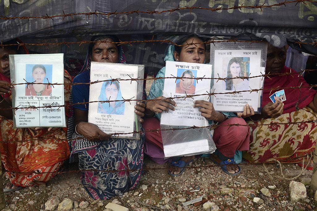 Le vrai prix des vêtements pas cher se paie en vies humaines. © Munir Us Zaman/AFP