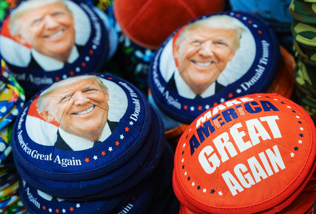 Kippahs with an image of the US President Donald Trump for sale seen in Mea She'arim Street, one of the oldest Jewish neighborhoods located in Jerusalem, seen just a few days before an introduction of the first preventive measures against the coronavirus spread by Israeli Government. On Tuesday, March 10, 2020, in Jerusalem, Israel. (Photo by Artur Widak/NurPhoto)