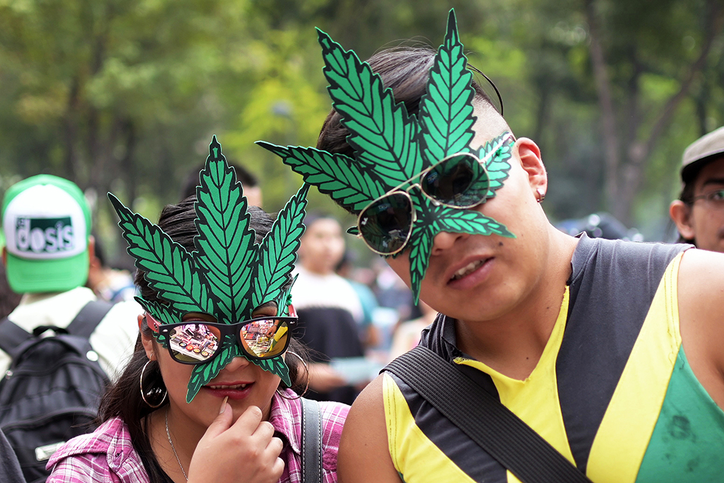 A couple attends a rally in support of the legalization of marijuana, at the Alameda Central Park in Mexico City, on May 4, 2019. (Photo by PEDRO PARDO / AFP)