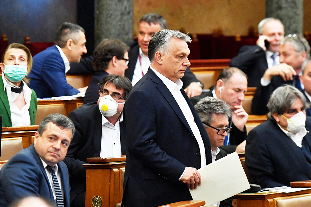 Hungarian Prime Minister Viktor Orban (C) walks near other representatives during a vote about the government's bill on the protection against the new coronavirus COVID-19 at the plenary session of the Hungarian Parliament in Budapest, Hungary on March 30, 2020. (Photo by Zoltan MATHE / POOL / AFP)