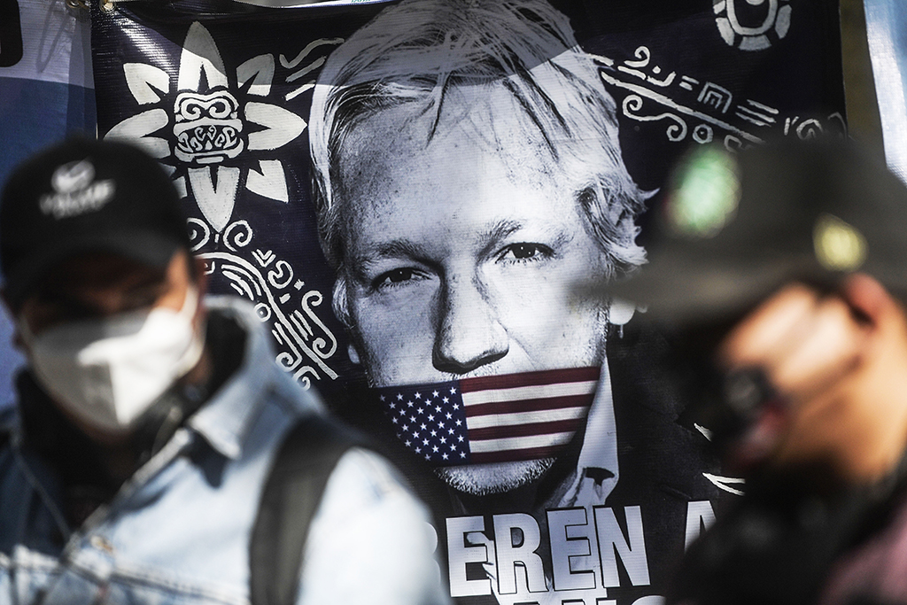 A flag is seen during a protest in front of the British embassy to demand the freedom of Wikileaks founder Julian Assange, in Mexico City, on January 4, 2021. - After British justice denied the US extradition request, Mexican president Andres Manuel Lopez Obrador offered political asylum to Assange. (Photo by Pedro PARDO / AFP)